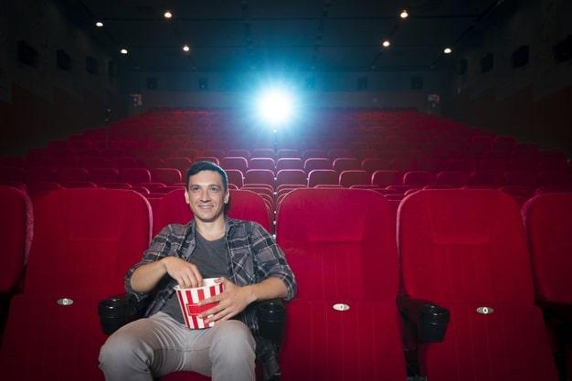 Man watching movie in cinema Free Photo